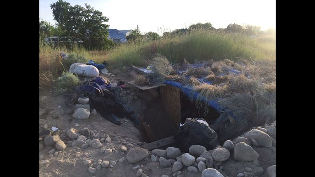Police recover stolen property from underground campsite